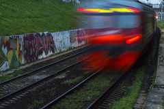 Railroad train fast motion. At night Royalty Free Stock Images