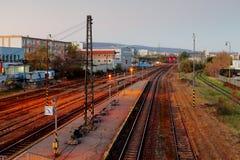 Railroad train platform at night Stock Photos