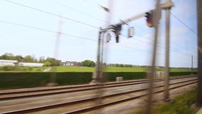 Railroad train speed moving. Fast rail way. High speed train. View from window moving train road. View from train during trip past countryside. Fast rail way stock footage