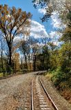Railroad trees sky stock image