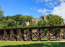 Railroad Trestle Harpers Ferry West Virginia. The Winchester and Potomac wooden train trestle parallels Harpers Ferry, West Virginia downtown area.  Built in Stock Photography