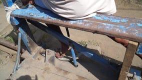 Railroad trolley operator drives foot driven passenger cart. San Pablo City, Laguna, Philippines - November 5, 2012: railroad trolley operator drives foot driven stock video