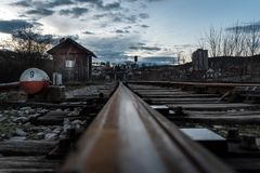 Railroad trucks at the time of sunset. Close up, selective focus Royalty Free Stock Image