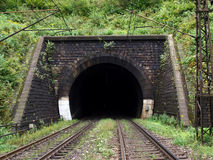 Railroad tunnel. Two rails entering in Stock Images
