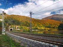 Railroad & Tunnel. View of the railroad tracks and tunnel along the Vah River near Sutovo village, Slovakia stock photography