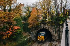 Railroad tunnel and autumn color in Charles Village, Baltimore, Maryland.  stock image