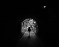 Railroad Tunnel with human silhouette Stock Photo