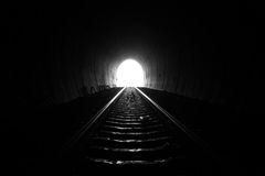 Railroad tunnel. Light at the end of railroad tunnel. Natural lighting Royalty Free Stock Photo