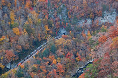 Railroad tunnel and Russell Fork river. The view of the railroad tunnel and Russell Fork river is a popular attraction at Breaks Interstate Park, Kentucky/ Royalty Free Stock Image