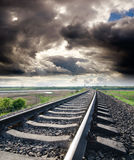 Railroad under cloudy sky Royalty Free Stock Photography