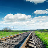 Railroad under cloudy sky Stock Photography