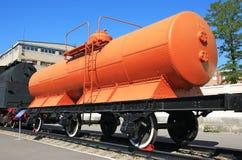 Railroad wagon. Orange railroad wagon waiting in the station Royalty Free Stock Photography
