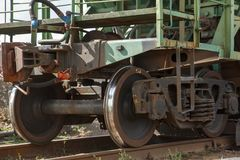 Railroad wagon. Rusty wheels of a green railroad wagon Stock Photography