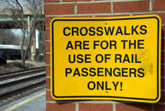 Railroad Warning Sign Rail Road. Sign limiting use of the train track crosswalk. Tracks in the background. Taken in Riverdale, maryland Royalty Free Stock Photo