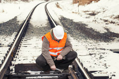 Railroad worker with adjustable wrench. In the hand Royalty Free Stock Photo
