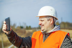 Railroad worker with tablet PC Stock Photography
