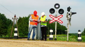 Railroad workers  near signal beacons Stock Photos
