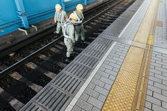 Railroad Workers in Osaka. Royalty Free Stock Photo
