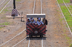 Railroadmen arrive by handmade vehicle. Royalty Free Stock Images