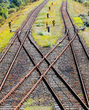 Railroads crossing on gravel in sunlight Stock Image