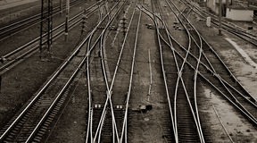 Rails. Interweaved Rails Resembling Interweaved People Destinies on Brown. Prospect of a railroad / railway branching. Train station with many tracks Stock Photos