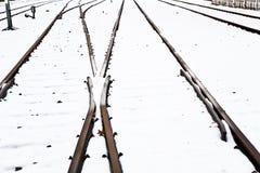 Rails bloqués par la neige en hiver Photo stock