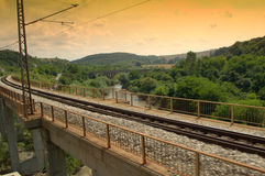 Rails and bridge crossing river Royalty Free Stock Photography