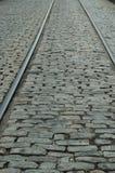 Rails & cobblestones. River Street, Savannah, Georgia stock image