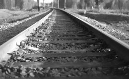 Rails and cross ties. Black-and-white picture of a site of the railway stock image
