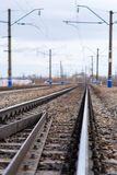 Rails, cross ties, columns, wires Royalty Free Stock Image
