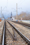 Rails, cross ties, columns, wires Royalty Free Stock Photo