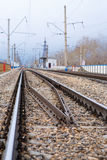 Rails, cross ties, columns, wires Stock Photography