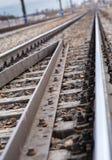 Rails, cross ties, columns, wires Stock Photos