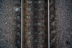 Rails and cross ties of railway among stones Royalty Free Stock Photography