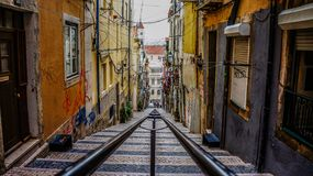 Rails down narrow alley Royalty Free Stock Photos