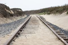 Rails in the dunes Royalty Free Stock Images