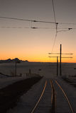 Rails in the Evening. Taken at the end of February on the Rigi Kulm, the rails of the Rigibahn glistening in the evening light royalty free stock photos