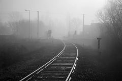 Rails in the fog. Rails in the winter fog - melancholy Stock Photography