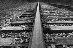 The rails go into the distance. In black and white Royalty Free Stock Photo