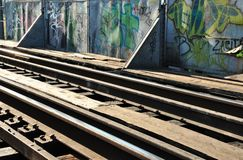 Rails and graffiti Stock Photography