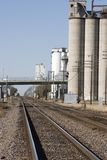 Rails and grain. Railroad line in the midwest along the side of grain elevators stock photo