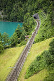 Rails leading to a tunnel in a mountain Stock Photography