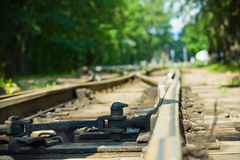 Rails move off. Sleeper and system of shunting railway points (in focus royalty free stock photo