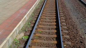 Railway journey POV. Rails passing by, slow motion from 120 FPS footage stock footage