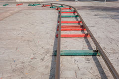 Rails, playgrounds. Rails playgrounds on cement background Stock Photos
