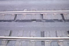 Rails. Railroad track sleepers grey background Stock Images
