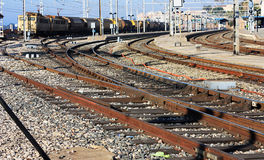 The rails of the railway. Railroad rails with freight train at station Stock Photos