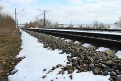 Rails of railway forward at winter. Rails of railway forward go into distance at winter Royalty Free Stock Photo