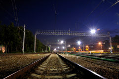 Rails of the railway at night Royalty Free Stock Images