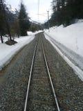 Rails. Red Bernina Train rails leading to St. Moritz Stock Photography